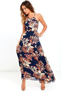 Getting out of town for a weekend? Don't forget to take along the Adventure Seeker Navy Blue Floral Print Maxi Dress! Navy blue chiffon, with a rust and cream floral print, flows from a high rounded neckline, to a sleeveless bodice with lace-up back. Full and flowy maxi skirt. Hidden back zipper.