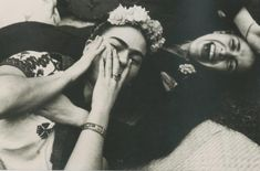 Frida Kahlo shares a laugh with Mexican singer Chavela Vargas in this candid photo by Nickolas Muray in 1945. There was much speculation surrounding the artists' relationship, as they were rumored to have had a lesbian affair.