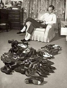 Fred Astair with his tap shoe collection.