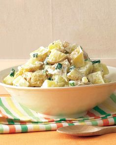 Combining the potatoes with the vinegar mixture while they're still hot allows them to absorb it all for a more flavorful salad.