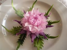Purple Orchid  by wtimm9, via Flickr This carving is carved from Korean purple radish into a carnation flower and garnish with melon skin that carve into leaves.