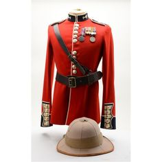 """Classic """"Red Coat"""" British dress uniform  jacket, likely for India service as the  uniform displays"""