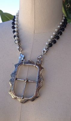 belt buckle necklace.  Recycle broken necklaces for the chain.