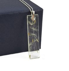 Resin pendant with dandelion seeds and sterling silver findings. Made by Agnaart https://www.etsy.com/listing/581627525/dandelion-seed-resin-pendant-sterling