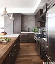 "Don't: Go overboard with storage and fill the walls with cabinets. ""There's rarely a need to completely fill a room with cabinets. A good layout is a balancing act between storage, function, and aesthetics,"" designer Robert Bakes says. In this New York kitchen he designed with Cecil Baker, open space above the sink means there's room to breath. Viking range and Sub-Zero refrigerator. Cabinet pulls from Doug Mockett & Co."