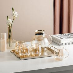 Champagne Gold Glass Teapot Set by Estilo Living is sure to turn heads at your next tea party, and will look amazing as part of your daily kitchen or dining room setting.Made from high quality heat-resistant Ion Plated Borosilicate Glass, this glass teapot set makes the preparation and serving of hot and cold drinks easy.  #teapot #teapotset #glassteapot #glassteapotset #kettle #glass #kitchen #homedecor #decor #scandinavian #nordic #tea