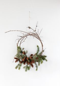 I like the contrast of bushy greens with the spiky twigs. Something I'll keep in mind for next year's wreath for the front window.
