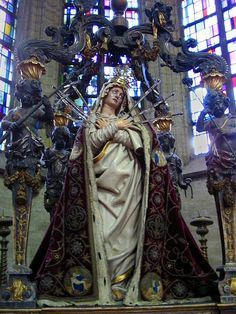 Our Lady of Seven Sorrows on a procession altar in the church of Our Lady over the Dijle (Onze Lieve Vrouw over de Dijle) in Mechelen, Belgium.The four cherubs on the altar's corners each hold an object connected to the passion of Christ.Source