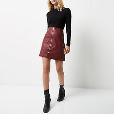 Leather look A-line shape Exposed zip front  Mini length