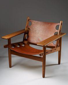 ERLING JESSEN, Armchair, 1960. Material oak and leather. Manufactured by Sören Horn, Denmark. / Modernity