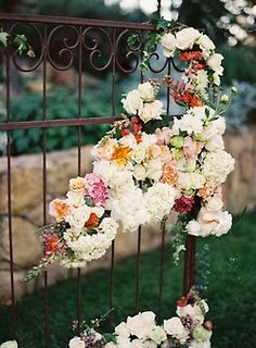 flower garland on gate for outside reception