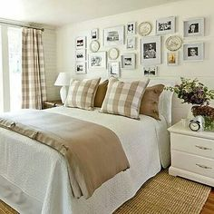 Guest bedroom with old family photos on the wall