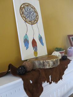Dreamcatcher focal point, painted by Mama's dear friend. Papa cut and finished the wood base