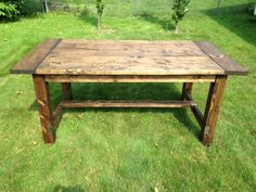 A classic and simple wooden dining table. Designed to seat a party of 6. Stained in Dark Walnut color and beautifully finished with a clear polyurethane. Handmade in Cleveland, Ohio. Size 71.5L x...