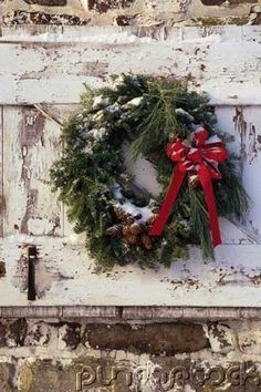 Wreath on weathered siding.. a touch of Christmas cheer!!!