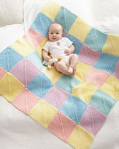 Perfect for baby showers, knit these colorful mitered squares and seam them together for a fun gift. (Bernat.com)