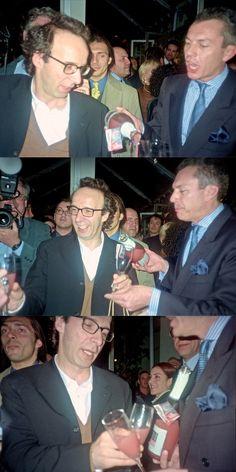 """Roberto Benigni toasting with Canella Bellini right after winning the Oscar for Italian movie """"La vita è bella"""" in Los Angeles. March 1999.  #bellini #oscar #losangeles #robertobenigni"""