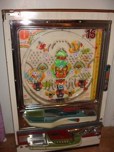 This is a fun game I own called Pachinko. It's a Japanese slot machine from the 1960's.