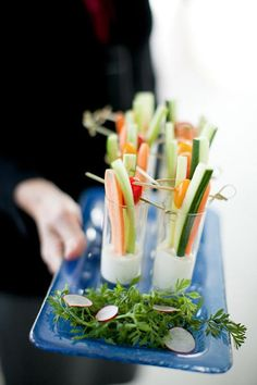 Place crudities in shot glasses with dip at the bottom | Brides.com