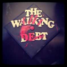 Walking dead theme grad cap I made for my husband- so appropiate