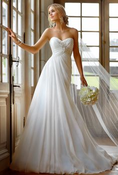 Brides: Stella York. Chiffon gown with sweetheart neckline and ruched bodice encrusted with crystal and lace detailing.��More Details From Stella York