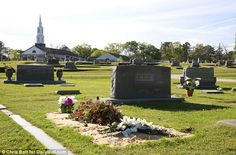 Mourned: Harper Lee's grave is beside that of her sister Alice in the town cemetery. Fresh tributes are left regularly to the town's towering literary figure Keeping Secrets, Harper Lee, Cemetery, Alice, America, Fresh, Memorial Park, Usa