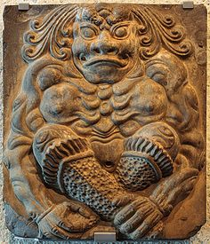 , Tile with guardian figure Tang dynasty (618-907) China Tile with guardian figure 7th-early 8th century from a Buddhist pagoda known as the Xiudingsi [Temple where contemplation is cultivated] Xiudingsi Pagoda, Henan province, China sculptures, Sculpture, stoneware Technique: moulded 43.5 h x 37.0 w x 14.0 d cm