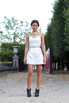 Christine Centenera wears Chanel dress. Celine necklace. Chanel boots.