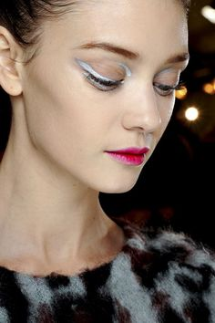 Christian Dior  Silver liquid liner was used at the inner and outer corners of the eyes,whilst lips were stained an almost neon pink.