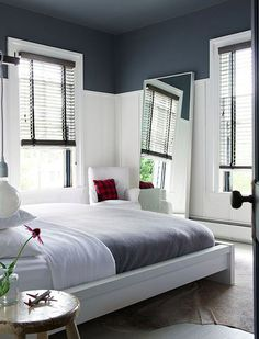 Painting the ceiling - Extend color down to the wainscoting for extra effect.