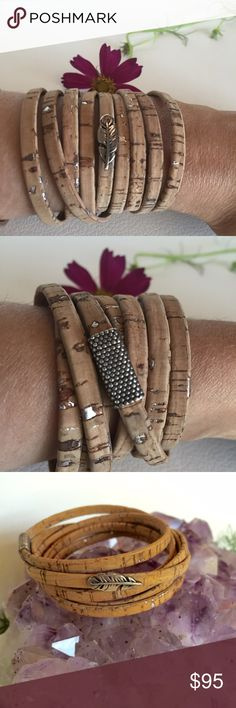 Silver & cork leather wrap bracelet & feather NWT Silver & cork leather wrap bracelet & feather Slide charm. NWT magnetic clasp. Wraps around multiple times and fits all sizes. NWT LADY DAISY Jewelry Bracelets