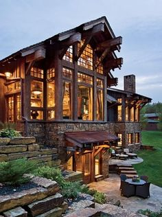 I like the use of stone and large wood beams together to give the house a solid look, but still allow plenty of windows for natural light.