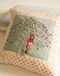 A beautifully embroidered pillow: a girl sitting on a tree.                                                                                                                                                                                 More
