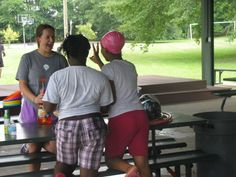 CYDC youth get a water balloon fill up from a PeopleMatter volunteer.