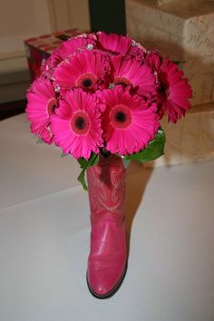 Centerpiece for shoe bridal shower theme! Put flowers in old shoes!  Love this color of pink.@Mi Chelle how cute is this!