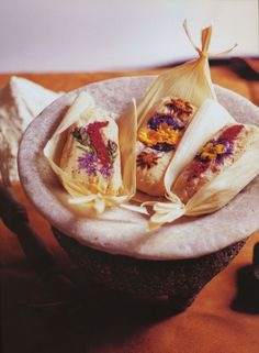 """Salmon Mousse Tamales These elegant tamales use edible flowers for both show and taste and embody the chef's New Mexico heritage. Find out how to make this dish – and others like it – with the """"Savor the Southwest"""" DVD or cookbook, available here! http://www.azpbs.org/savorthesouthwest/order.php Chef: John Rivera Sedlar Course: Entree Cuisine: Mexican, American Occasion: Party, Cookout Theme: Seafood, Meat Time: Tamale dough – 15 minutes Salmon mousse – 10 minutes Assembly – 45 minutes"""