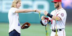 Katie Ledecky Has Bryce Harper Hold Her Medals While She Pitches