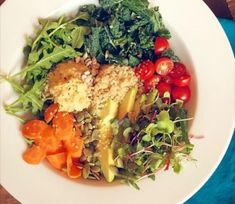 Load up on veggies with a Hummus & Quinoa Superfood Veggie Bowl. www.elizabethrider.com #recipe #eatclean #superfood