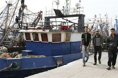 In this photo taken on Thursday, Dec. 12, 2013, fishermen walk along the docks of Marsa Port in the Western Sahara where most working in the fishing industry are immigrant workers from Morocco. (AP Photo/Paul Schemm) ▼1Jan2014AP|Tensions high in Western Sahara despite new plan http://bigstory.ap.org/article/tensions-high-western-sahara-despite-new-plan #Marsa_Port_Western_Sahara