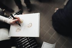 Emily Brickel sketches backstage. Nanette Lepore Fall 2015 - Posh Rebel (Photo by Lord Ashbury)