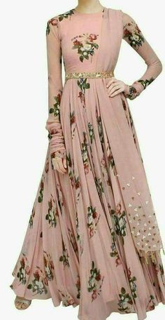 We are to breathe life into your aspirations and to make a mark in the world of style. Add richer looks to your persona in this majestic peach colour stitched gown. It is uniquely floral print. Indian Attire, Indian Wear, Indian Outfits, Indian Gowns Dresses, Pakistani Dresses, Indian Designer Outfits, Designer Dresses, Party Kleidung, Anarkali Dress