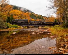 Photo freight crosses the Cheat River high in the mountains of West Virginia. A Chase Gunnoe Charter.