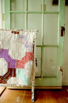 love old quilts  and chipped paint