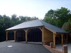 3 bay oak framed carport with log store