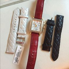 Michele watch Michele stunning watch . Diamonds all around with gold silver face ! Very fancy watch I never worn this watch . I have to other straps black and pearl and they never been use either. Thanks for shopping  Michele Jewelry