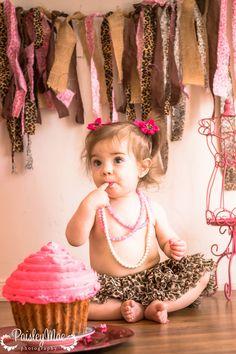 First birthday cake smash cute little girl cheeta prints