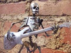 Skeleton Zombie Playing Bass Guitar Steel Sculpture by zedszombieranch for $59.00