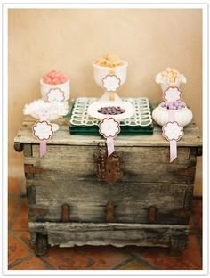 Pastel purple and peach candy bar on a vintage spanish wood trunk