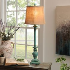 Add a pop of color and a touch of vintage flair to your home with the Turquoise Classic Buffet Lamp! It's perfect for entryways or side tables that need a little light.