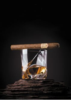whisky with a cigare. The way to roll. Only the glass can be better :-).  www.cigarmanor.om